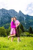 """Постер, картина, фотообои """"Счастливая пара в альпийский луг"""""""