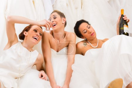 Brides drinking too much in wedding shop or store