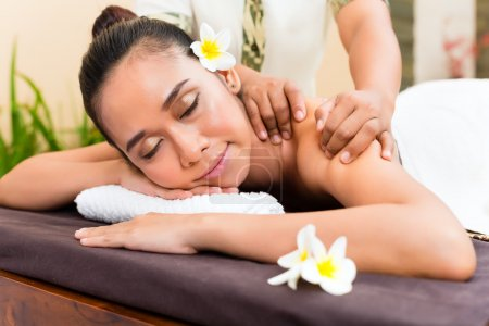 Indonesian woman having aroma therapy massage
