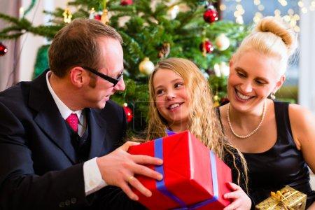 Family with Christmas gifts on boxing day