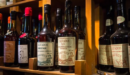 Bottles of calvados on the shelves.