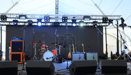 An empty Stage Before the Concert with floodlight and musical instruments
