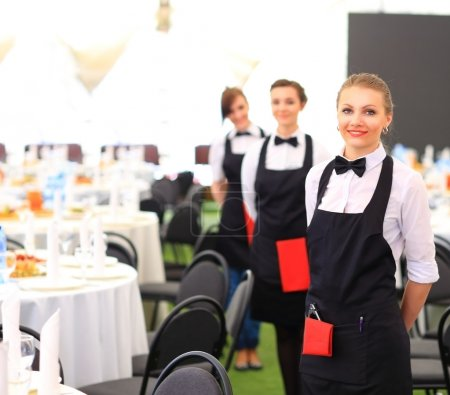 Photo for Large group of waiters and waitresses standing in row. - Royalty Free Image