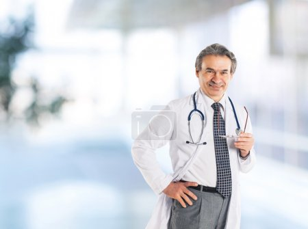 Adult qualified physician diagnostician, with a stethoscope,