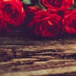 Roses on old wooden board, Valentines Day background, wedding day