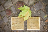 Berlin - Germany - October 02 Stolperstein (Stumbling Block), a monument created by Gunter Demling wchich commemorates a victim of the Holocaust. Small,  memorials located on the pavements.