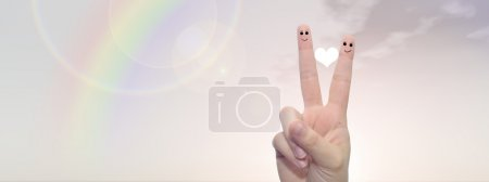 Photo for Concept or conceptual human or female  two fingers tand smiley faces over rainbow sky banner background - Royalty Free Image
