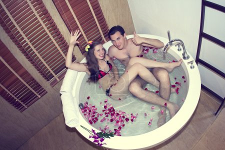 Honeymoon. Newlyweds in hotel in a jacuzzi