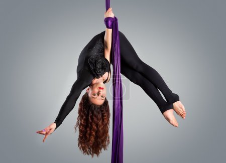 Photo for Beautiful dancer on aerial silk, aerial contortion, aerial ribbons, aerial silks, aerial tissues, fabric, ribbon, tissue - Royalty Free Image