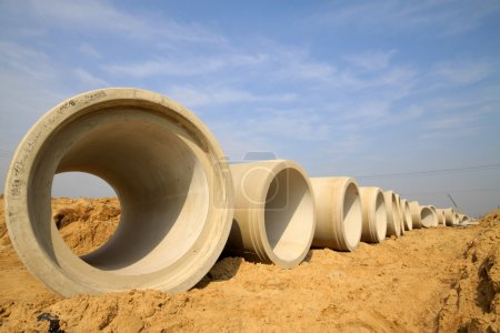 Photo for Underground drainage pipeline construction. concrete pipes on ground - Royalty Free Image