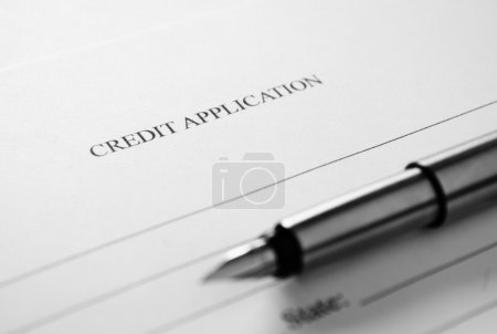 Credit application form and fountain pen