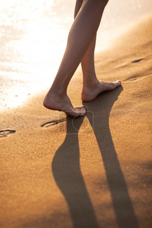 Walking barefoot on the beach