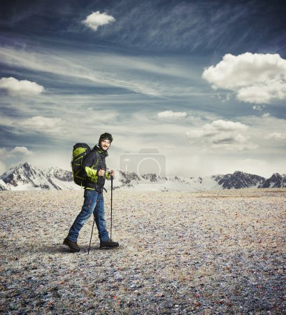 Photo for Man wear winter clothes with hiking poles and goggles in the mountains - Royalty Free Image