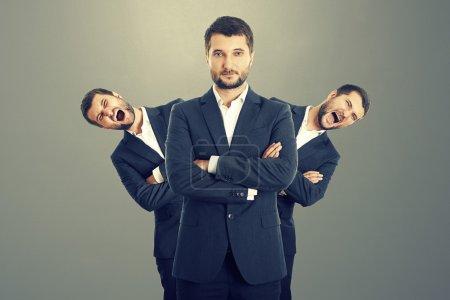 screaming men behind confident businessman