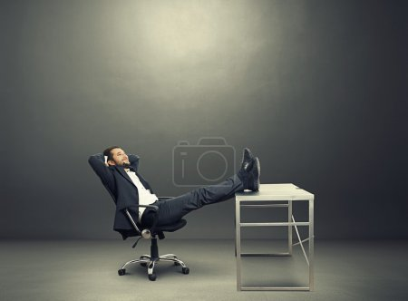 Businessman put his feet up on the table