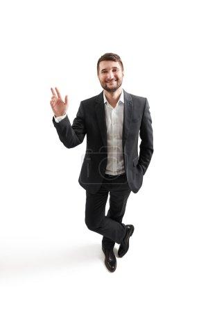 Man in formal wear waving his hand