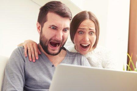 amazed screaming couple