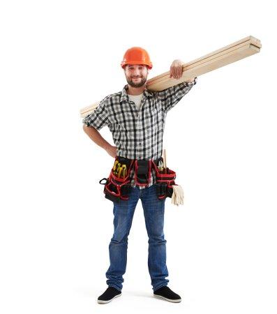 Builder holding long wooden boards