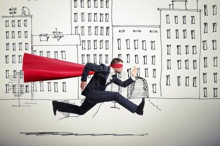 superhero running in drawing street