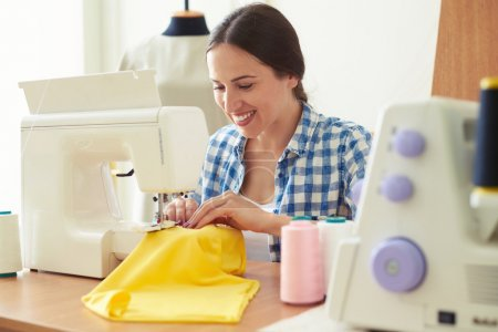 woman working on sewing machine