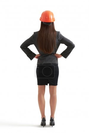 Woman in formal wear and orange hardhat