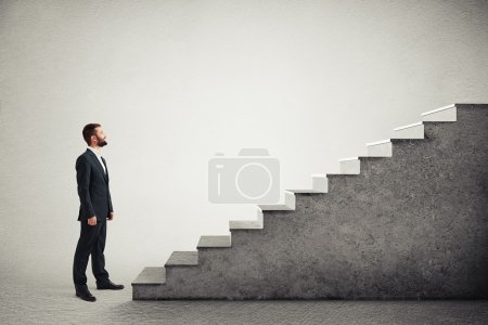 man standing near concrete stairs