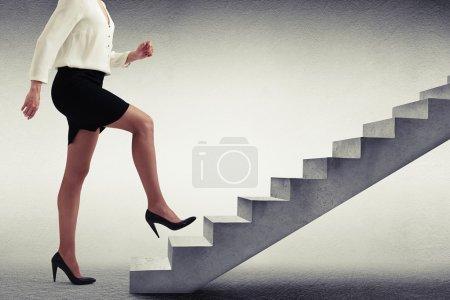 Woman in formal wear walking up stairs