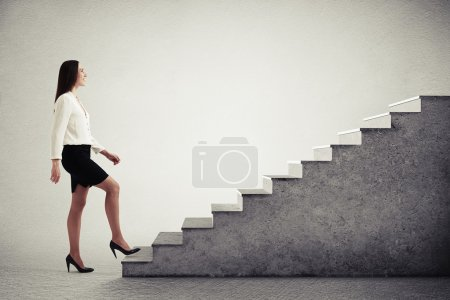 woman walking up concrete stairs