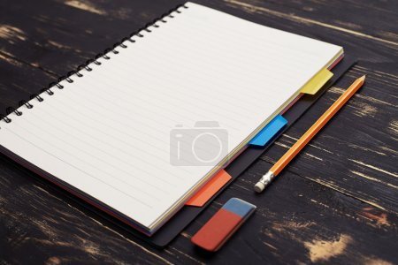 notepad and pencil on wooden table