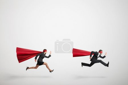 superman and superwoman fast running
