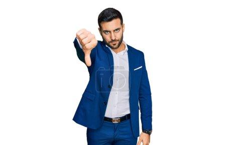 Young hispanic man wearing business jacket looking...