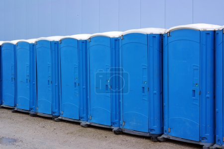 Photo for Row of porta potties at a public event - Royalty Free Image