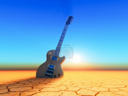 Photo for An electric guitar planted  into the desert ground - Royalty Free Image