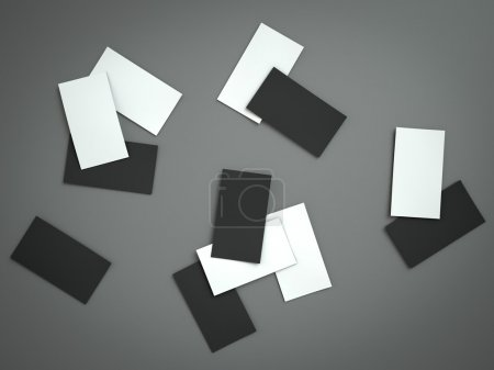 Stack of blank business card on grey background.