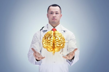 Doctor with stethoscope and gold brains on the hands . High resolution.