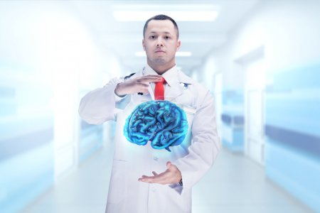 Doctor with stethoscope and brains on the hands in a hospital. High resolution.