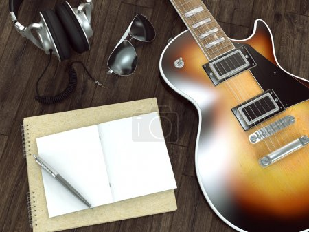 Guitar on wooden background.