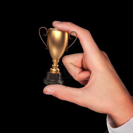Winner cup in hand.