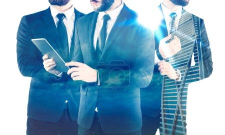 Double exposure of three businessmen