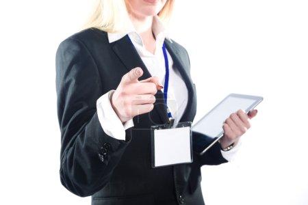Photo pour Femme d'affaires, pointant son doigt sur l'espace copie vide, isolé sur fond blanc - image libre de droit