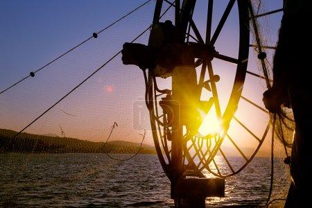 Fishing on boat in sea