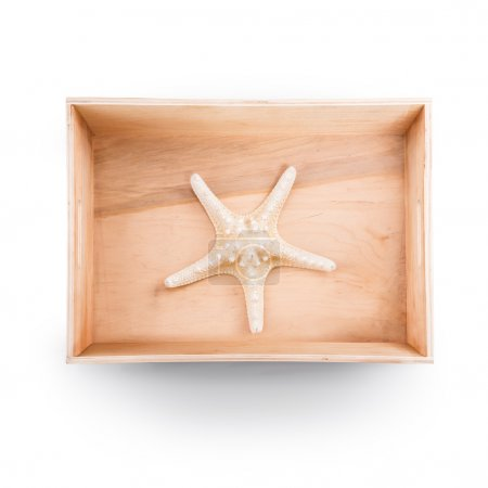 Top view of  wooden box. Starfish inside