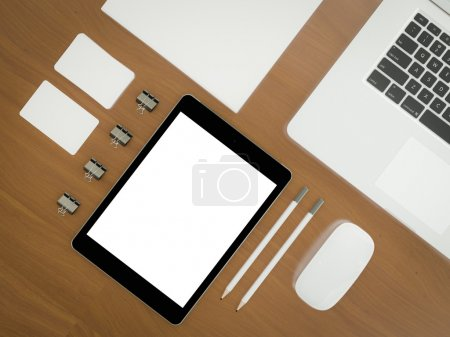 Mockup business template. Set of elements on the braun wooden table.