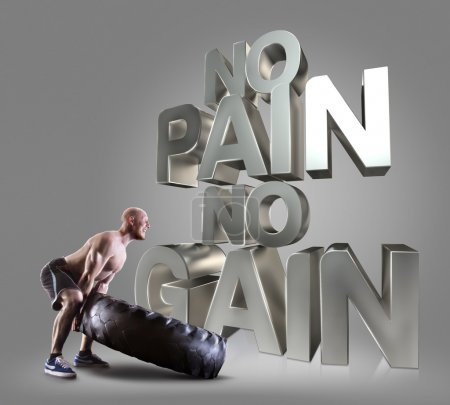 Athletic young man lifting a tire on the gray background Motivational fitness phrases