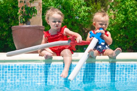 Happy children playing in the pool