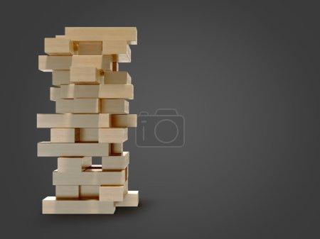 Blocks wood game  jenga  on black background.