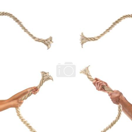 Photo pour Mains de gens tirant la corde sur fond blanc. - image libre de droit