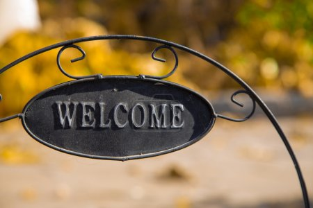 Decorative garden with Welcome Iron Signboard on Nature  background