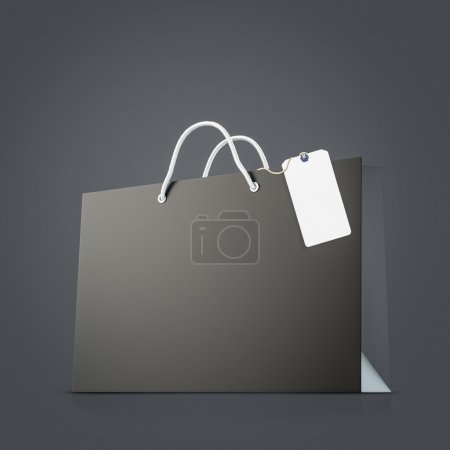 Back strong paper shopping bag with tag on dark background