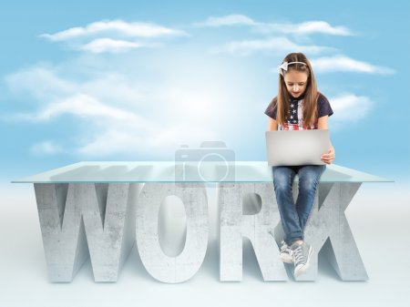 Cute little girl sitting on a WORK table design, and holding a laptop on sky backrgound. Bussines concept
